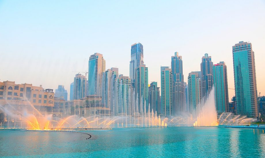 photo-of-water-fountain-across-high-rise-buildings-3145426
